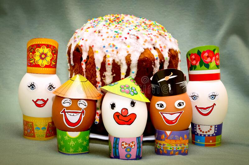 Orthodox Easter holiday, eggs, cake. Orthodox Easter holiday, close-up decoratively decorated eggs, cake in the background royalty free stock images