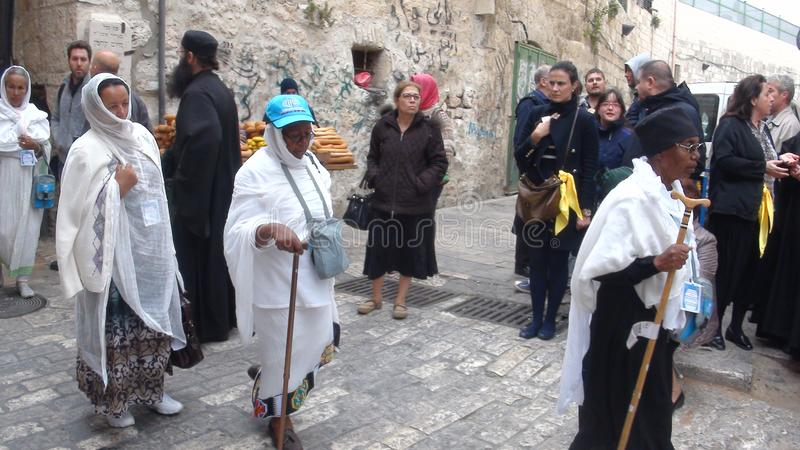 Orthodox Ethiopian Christians mark Good Friday in Jerusalem and carry wooden crosses in a procession along the Via Dolorosa. royalty free stock photography