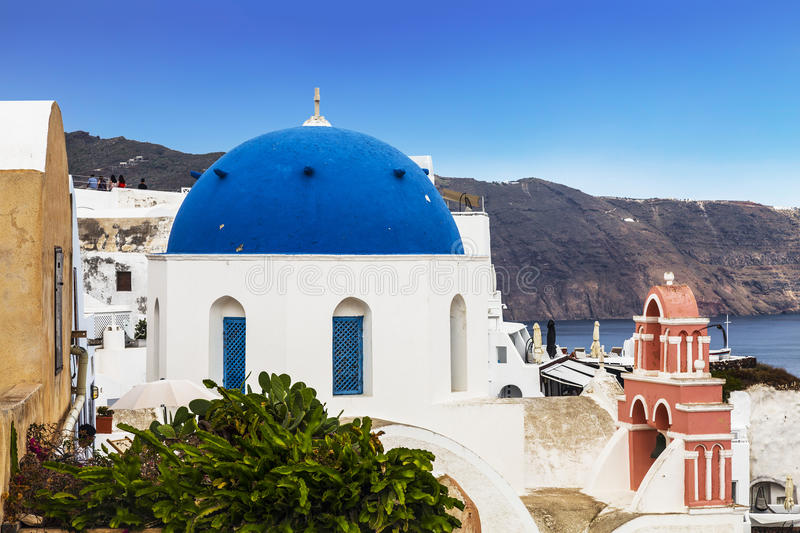 The Orthodox Greek Church of St. Nicholas in the city of Oia on the island of Santorini. In Greece stock photography