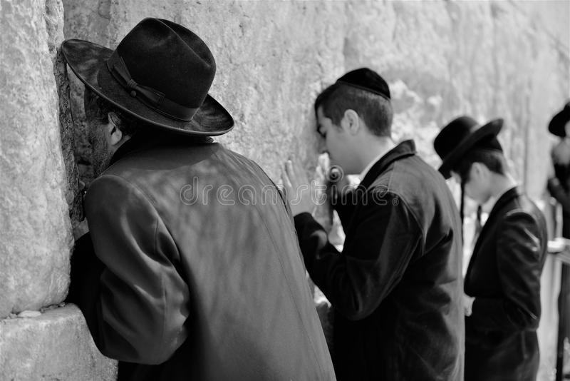 Orthodox hassidic religious jews dressed in black traditional outfit pray at the wailing wall. Orthodox hasidic religious jews dressed in black traditional royalty free stock photography