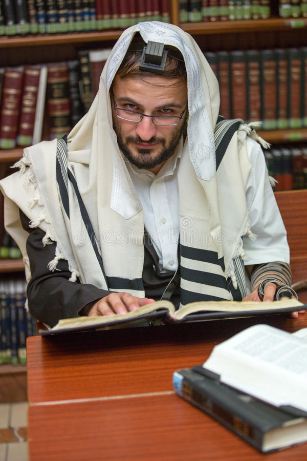 Orthodox learns Torah. Orthodox learns Talmud sitting in the synagogue royalty free stock photography
