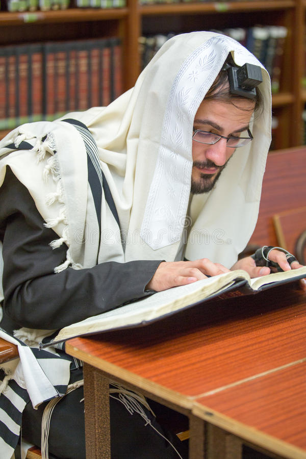 Orthodox learns Torah. Orthodox learns Talmud sitting in the synagogue royalty free stock image