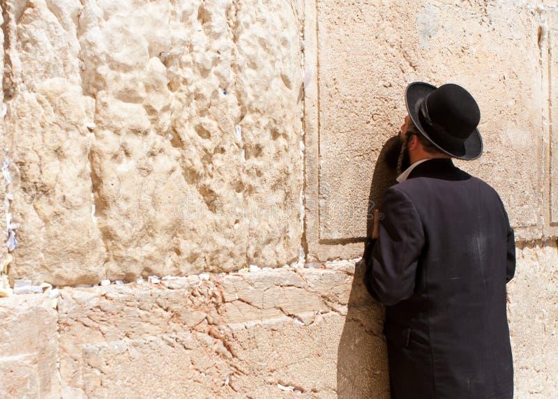 Orthodox Jewish Man prays at the western wall stock photos