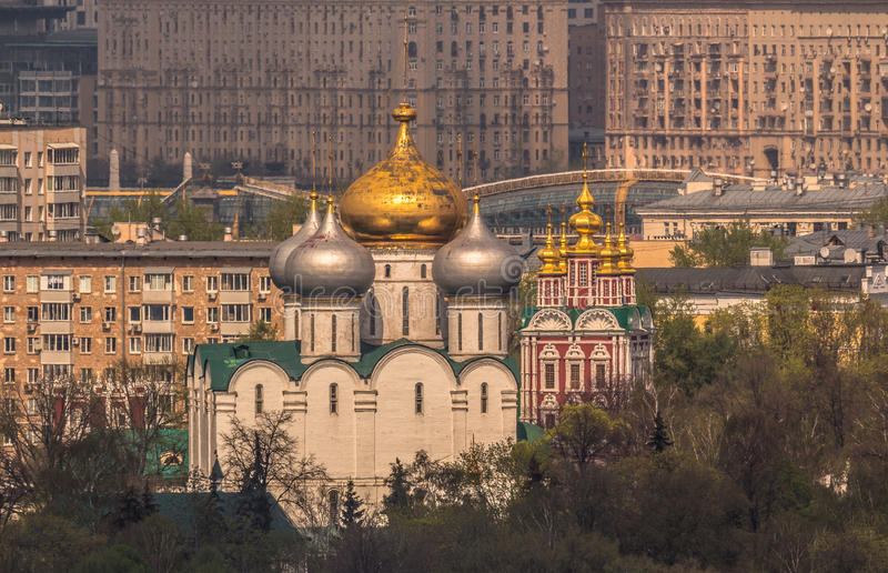 Orthodox Novodevichy Convent in Moscow on a background of city houses under summer sun stock photo