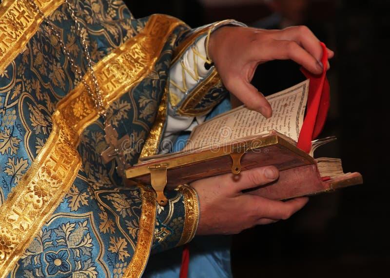 Orthodox priest. The Orthodox priest reads Biblia stock photos