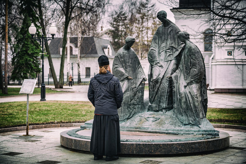 Orthodox priest at the sculpture royalty free stock images