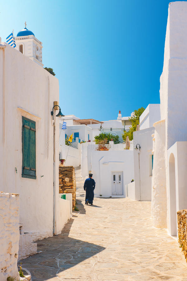 Download Orthodox Priest In Sifnos Alleyway Stock Image - Image of cobblestone, morning: 26484939