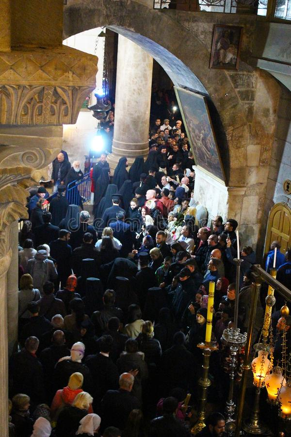 Orthodox priests and pilgrims in The Church of the Holy Sepulchre stock image