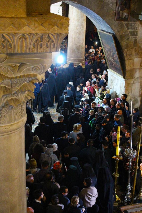 Orthodox priests and pilgrims in The Church of the Holy Sepulchre royalty free stock photo