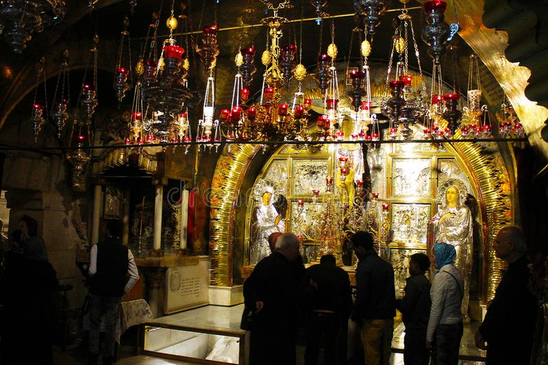 Orthodox priests and pilgrims in The Church of the Holy Sepulchre stock photos