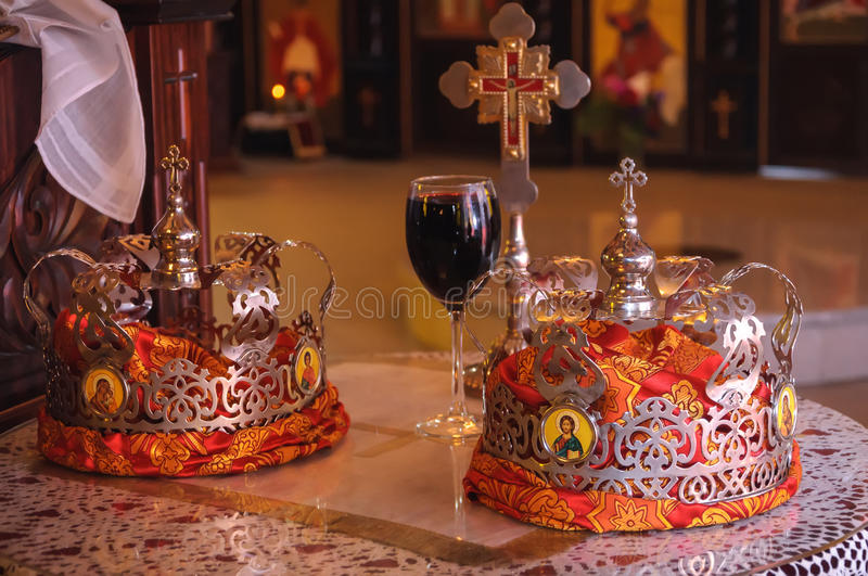 Orthodox Wedding Crowns. Wedding Crowns, cross and a glass of Wine in the Orthodox Church royalty free stock image
