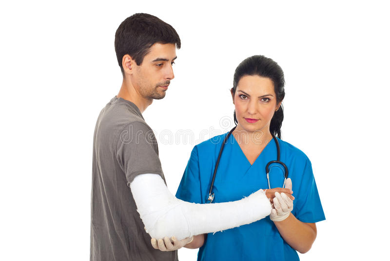 Orthopedic doctor with male patient stock photo