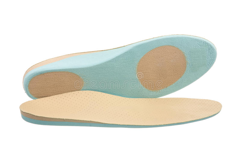 Orthopedic Shoe Insoles. Closeup of a pair of orthopedic shoe insoles royalty free stock image