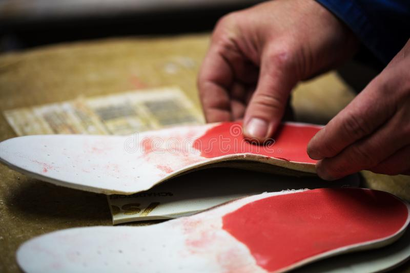 Orthopedic shoemaker masters deposits. Foot, soft, pad stock image