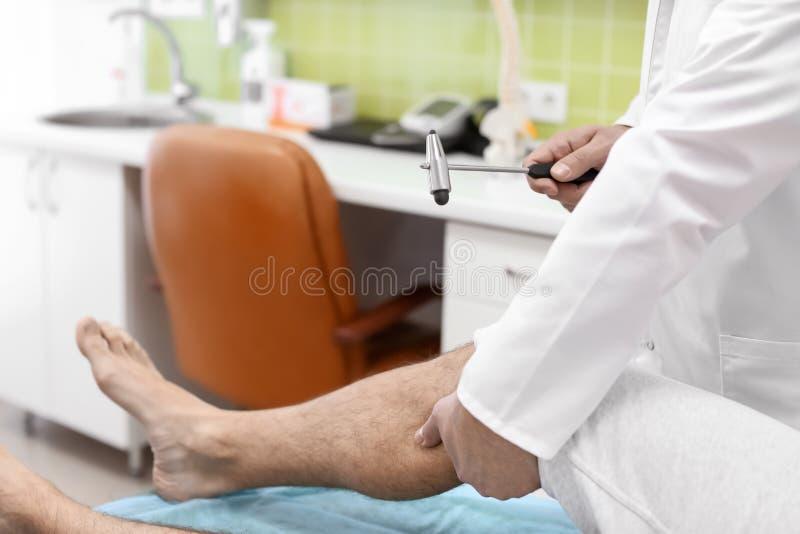 Orthopedist examining patient in hospital stock image