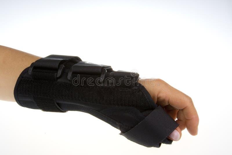 Orthosis de poignet sur le blanc d'isolement photographie stock
