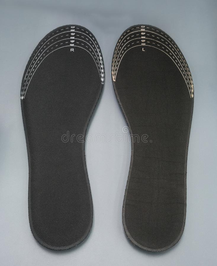 2aa556c3d04 Orthotics στο γκρίζο υπόβαθρο Ένθετο στα παπούτσια στην υποστήριξη στοκ  εικόνες