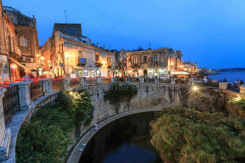 Ortigia in Syracuse night scene. The architecture and buidlings of the Old Town on the island of Ortigia in Syracuse, Sicily illuminated at night with the royalty free stock images