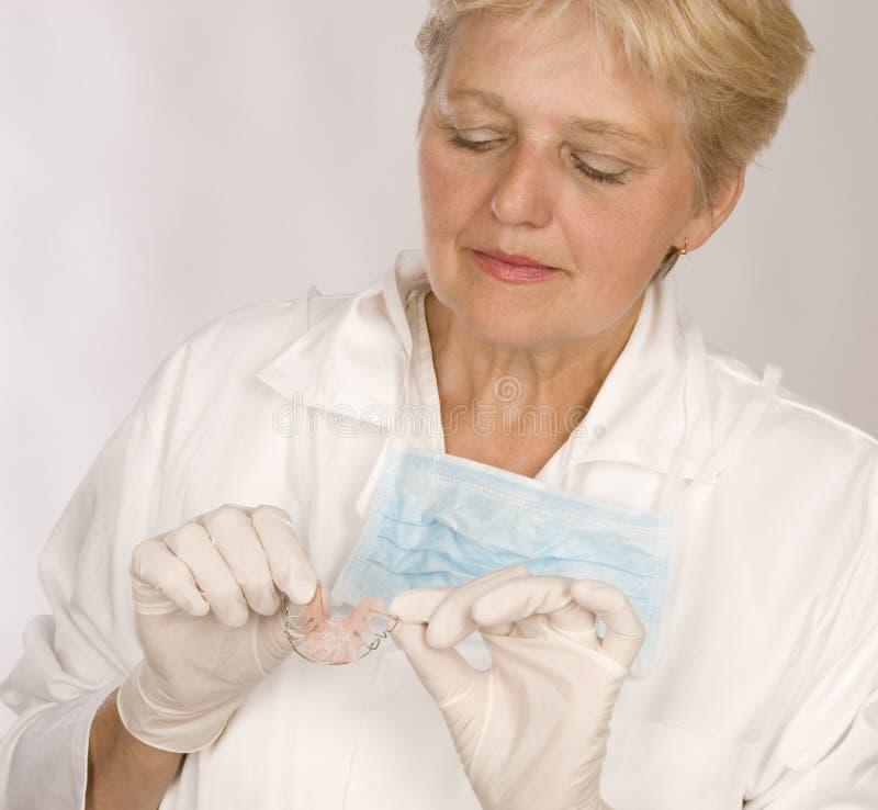 Ortodoncia del dentista de la mujer imagenes de archivo