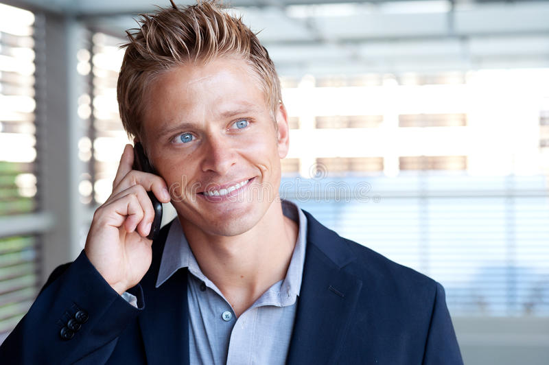 Download Ortrait Of Handsome Business Man Using Cell Phone Stock Photo - Image: 26522330