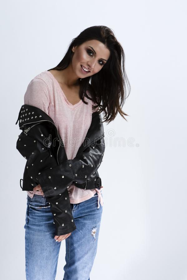 Ortrait of Happy Smiling Caucasian Brunette Girl in Leather Jacket royalty free stock photo