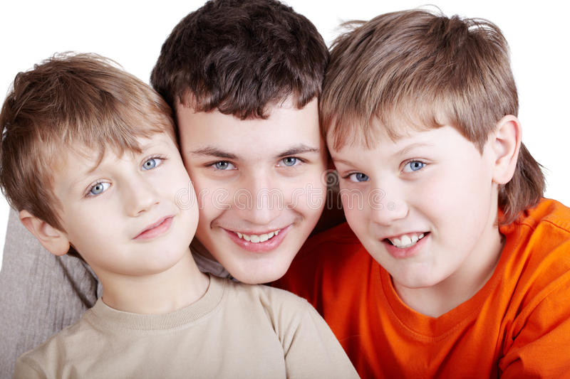 Ortrait of three smiling boys royalty free stock images