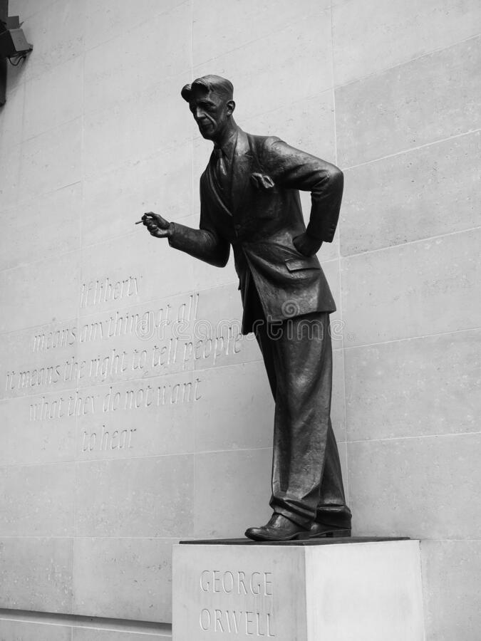 Orwell statue at BBC Broadcasting House in London, black and whi. LONDON, UK - CIRCA SEPTEMBER 2019: George Orwell in front of BBC Broadcasting House in Portland royalty free stock images