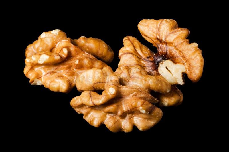 Orzechów włoskich nasiona, dokrętki odizolowywać na czarnym tle zdjęcie royalty free