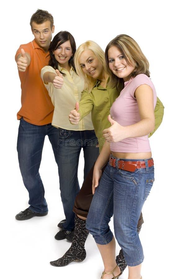 Os adolescentes que mostram a mão APROVADA cantam fotos de stock royalty free