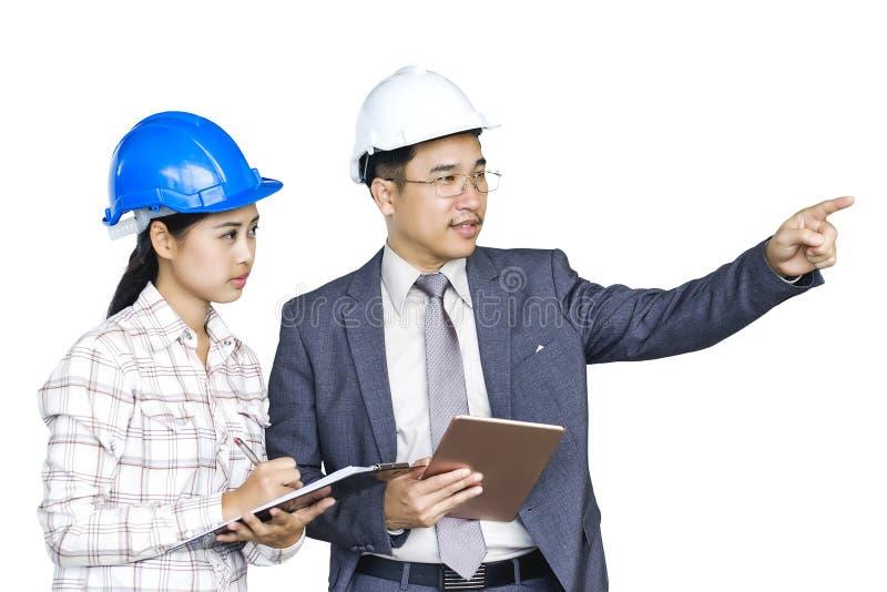Os arquitetos masculinos asiáticos, coordenadores fêmeas estão discutindo seu burro imagem de stock