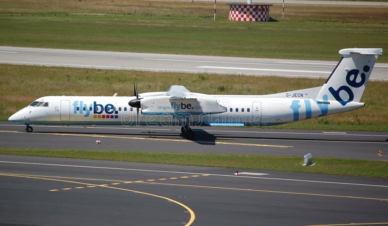 Os aviões de Flybe descolam fotografia de stock