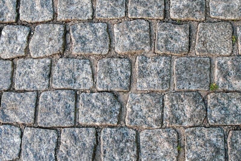 Os blocos de pavimentação antigos de mármore imagem de stock royalty free
