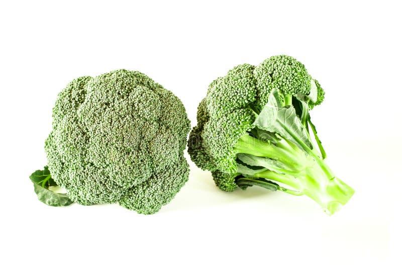 Os br?colis verdes encontram-se em um fundo branco imagem de stock royalty free