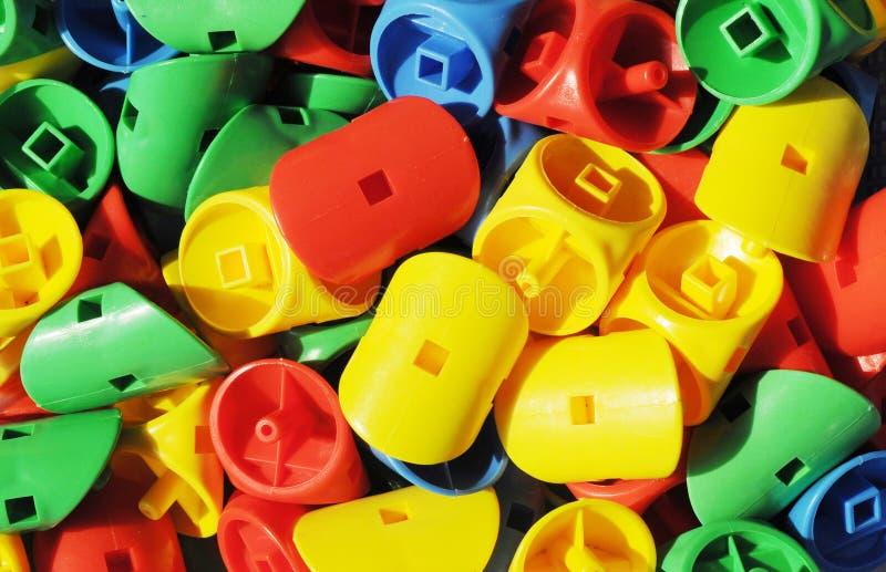 Os brinquedos plásticos de cores brilhantes fotos de stock royalty free