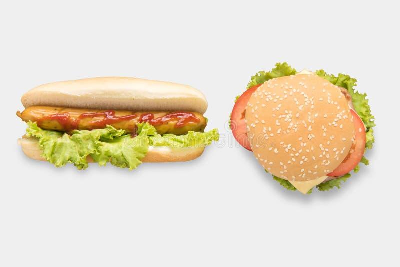 Os cachorros quentes e os Hamburger do modelo ajustaram-se isolado no fundo branco imagem de stock