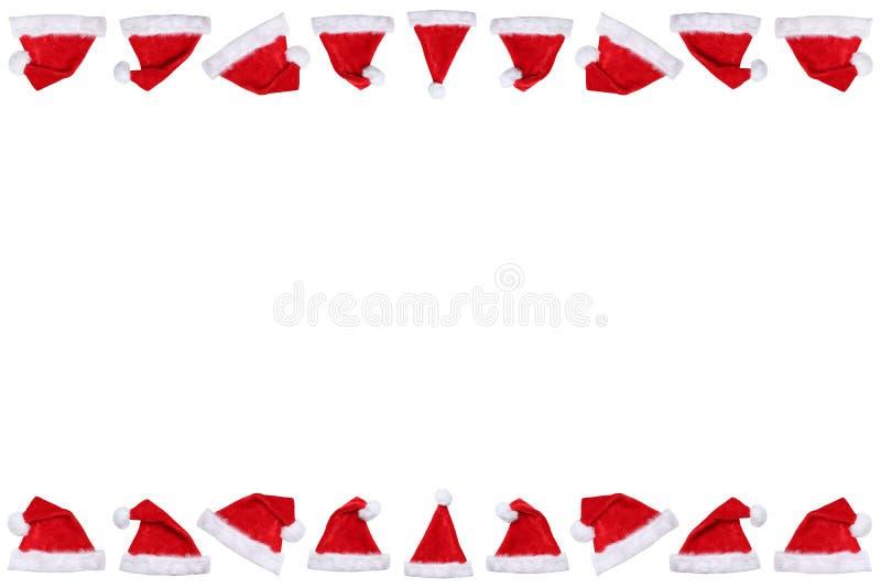 Os chapéus do chapéu de Santa Claus no Natal limitam wi do espaço da cópia do copyspace imagens de stock