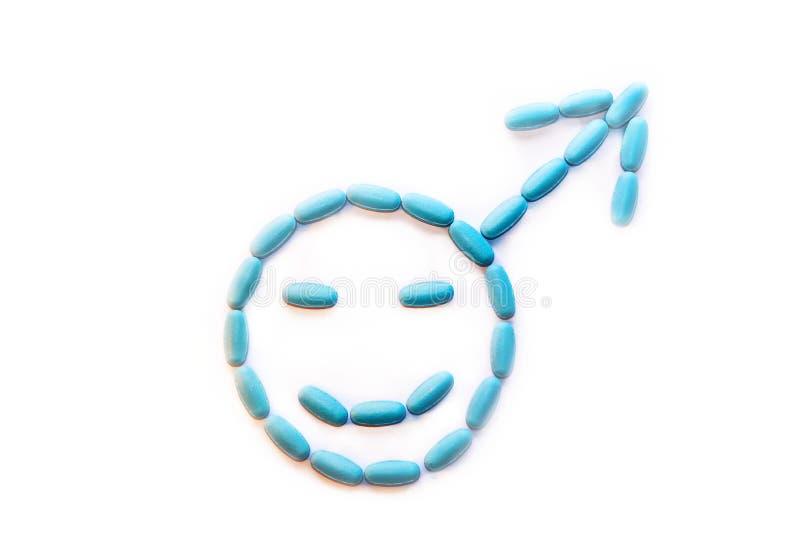 Os comprimidos de Viagra são apresentados no símbolo do masculino Um aumento na potência e na ereção Saúde do ` s do homem Medici imagem de stock royalty free