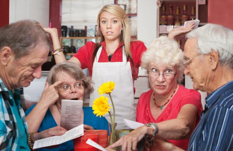 Os consumidores discutem sobre o menu foto de stock royalty free