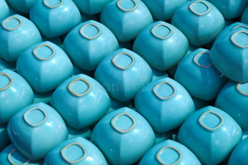 Os copos quadrados azuis arquivam sobre imagens de stock royalty free