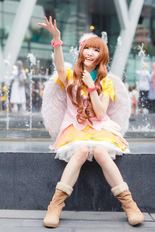 Os cosplayers tailandeses vestem-se como os caráteres dos desenhos animados e do jogo no festa de Japão em Banguecoque imagens de stock