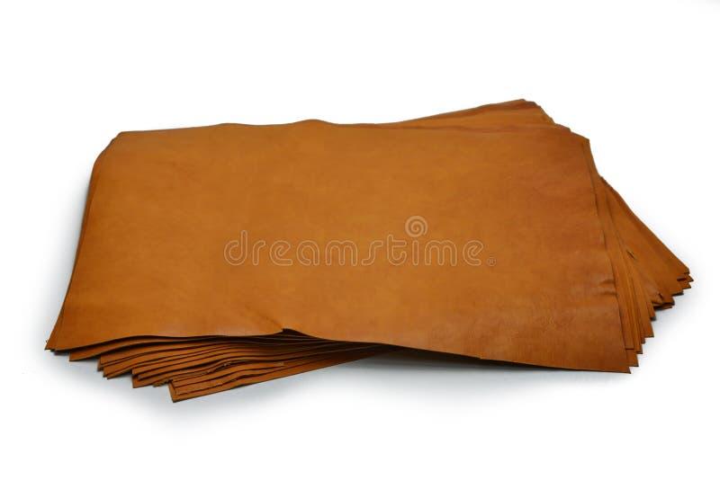 Os couros aparados macios no rolo grosso estabelecem na tabela foto de stock