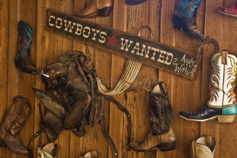 Os cowboys quiseram o sinal foto de stock