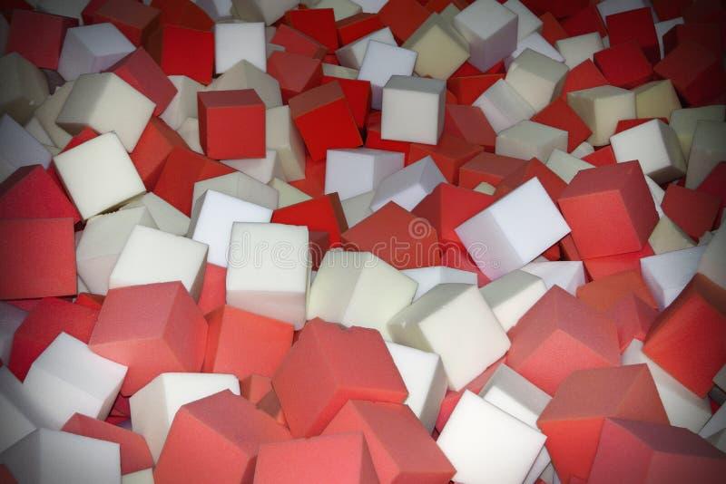 Os cubos coloridos da borracha de espuma no trampolim pit o fundo do close-up foto de stock royalty free