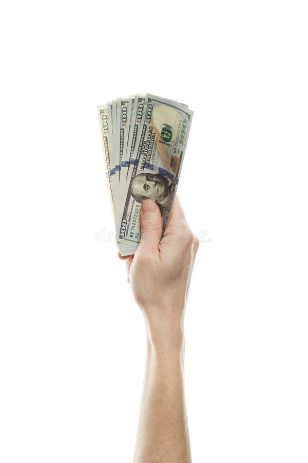 Os dólares americanos descontam o dinheiro e a mão masculina isolados no fundo branco Dólares americanos modernos 100 da cédula à imagem de stock