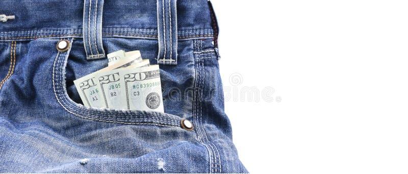 Os dólares americanos ou o dinheiro em calças de brim azuis da sarja de Nimes Pocket, conceito no dinheiro do salário, dinheiro d imagens de stock royalty free