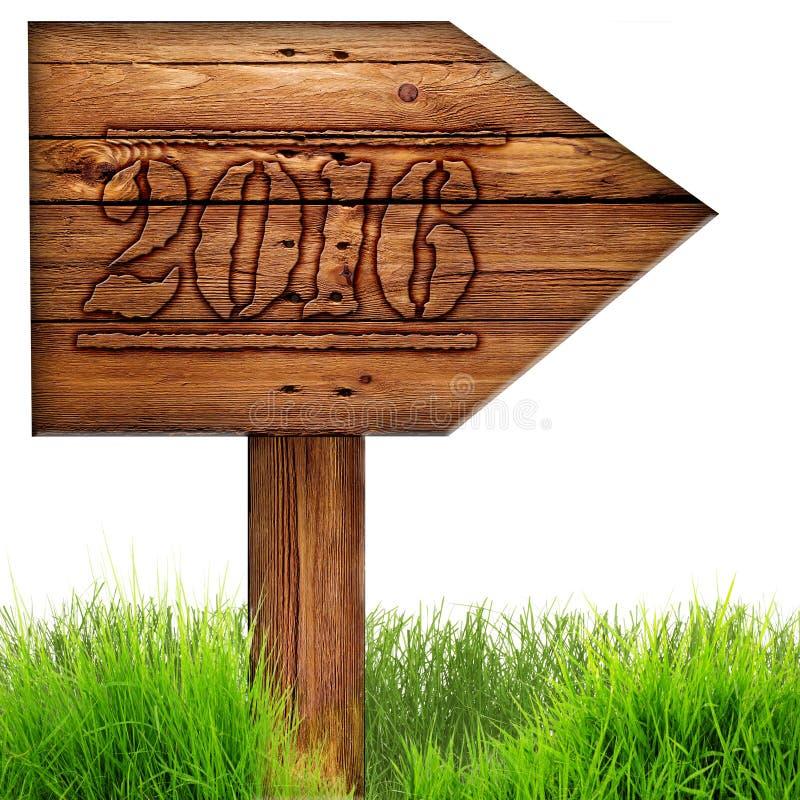 Os dados 2016 queimaram-se no sinal de madeira da seta contra no fundo branco imagem de stock royalty free