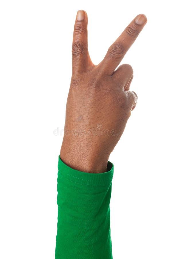 Os dedos formam o sinal da vitória fotos de stock