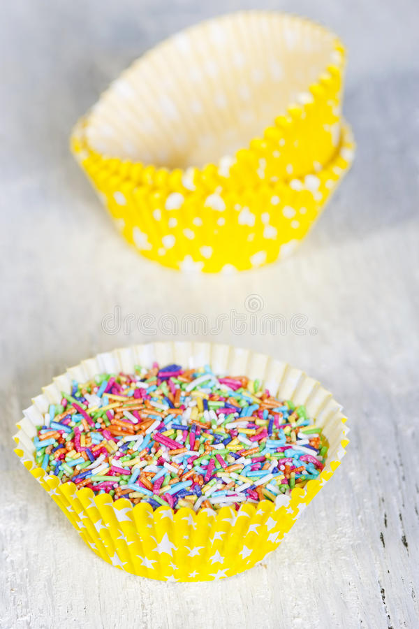 Os doces coloridos polvilham imagens de stock royalty free