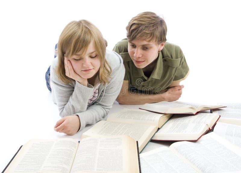 Os dois estudantes novos isolados em um branco fotos de stock