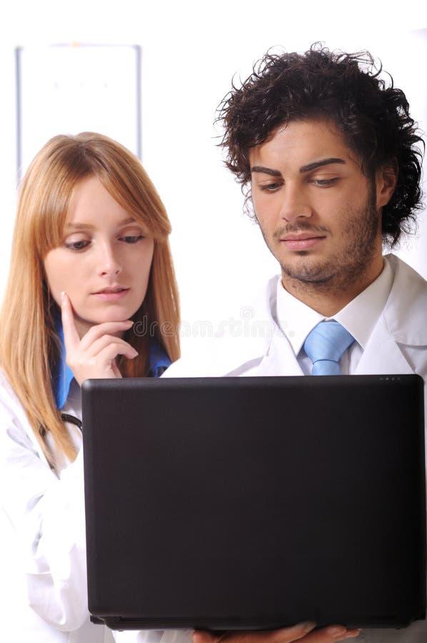 Portátil novo do uso dos doutores imagens de stock